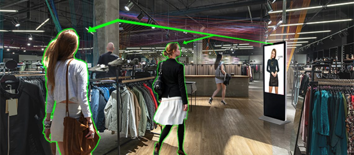 Big clothing store with dark ceiling with hanging luminous lamps, concrete columns and multicolored ropes lines installations. There are many hangers with different clothes, shoes, cash desk.